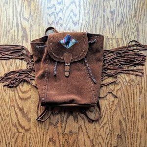 Brown leather fringe packpack
